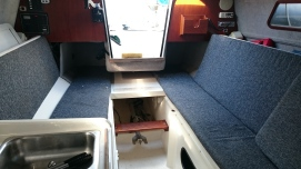 interior looking aft: slide out bunk just above the step