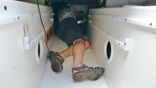 Jim inspecting under the cockpit