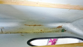 Damage under the settee in the storage area